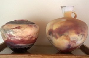 Large unglazed pots, white clay, pit-fired on a beach in northern California with cow dung fuel and seaweed