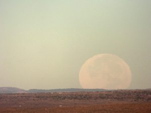 Supermoon setting over central New Mexico at dawn, mid-October 2016