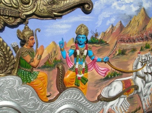 Colorful relief of Krishna with blue skin instructing Arjuna in a chariot.